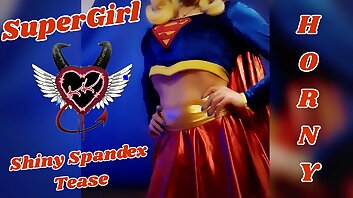 SuperGirl in Shiny Spandex Teases and Plays with Herself